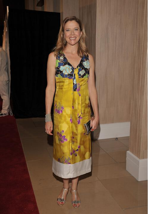 Annette Bening in a yellow floral dress