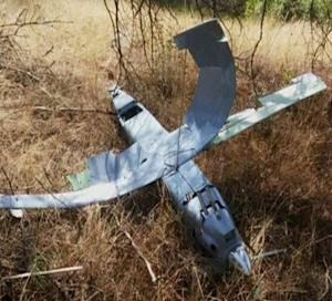 A still photograph used in a video shows a downed drone in Deliosman Village