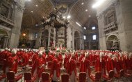 "Cardinals leave after a mass in St. Peter's Basilica at the Vatican March 12, 2013. All cardinals, including those over 80 who will not vote in the conclave, celebrate Mass in St Peter's Basilica to pray for the election of the new pope. The Mass is called ""Pro Eligendo Romano Pontefice"" (""For the Election of the Roman Pontiff"") and is open to the public. REUTERS/Stefano Rellandini"