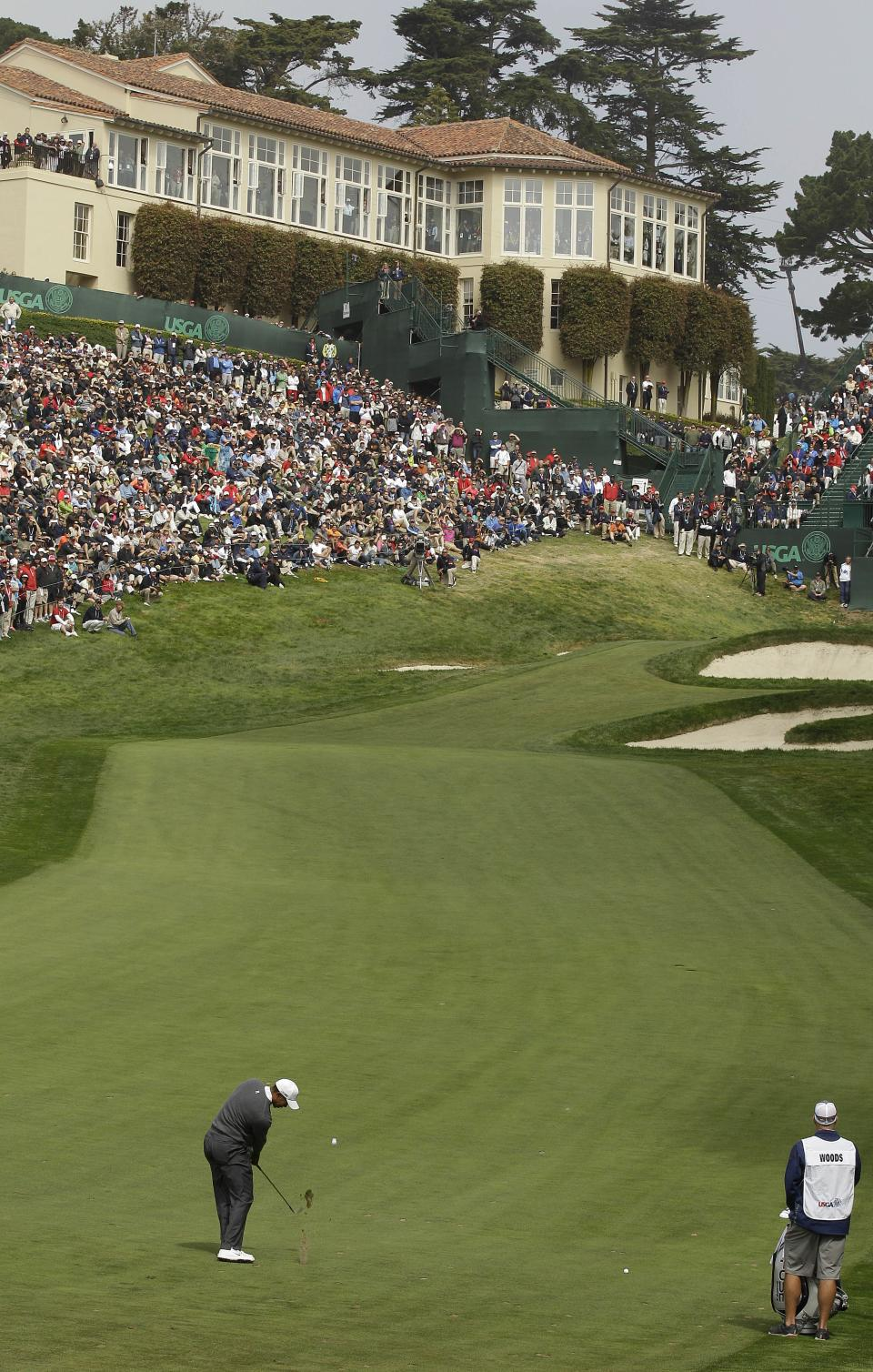 Tiger Woods takes a shot on the 18th hole during the first round of the U.S. Open Championship golf tournament Thursday, June 14, 2012, at The Olympic Club in San Francisco. (AP Photo/Charlie Riedel)
