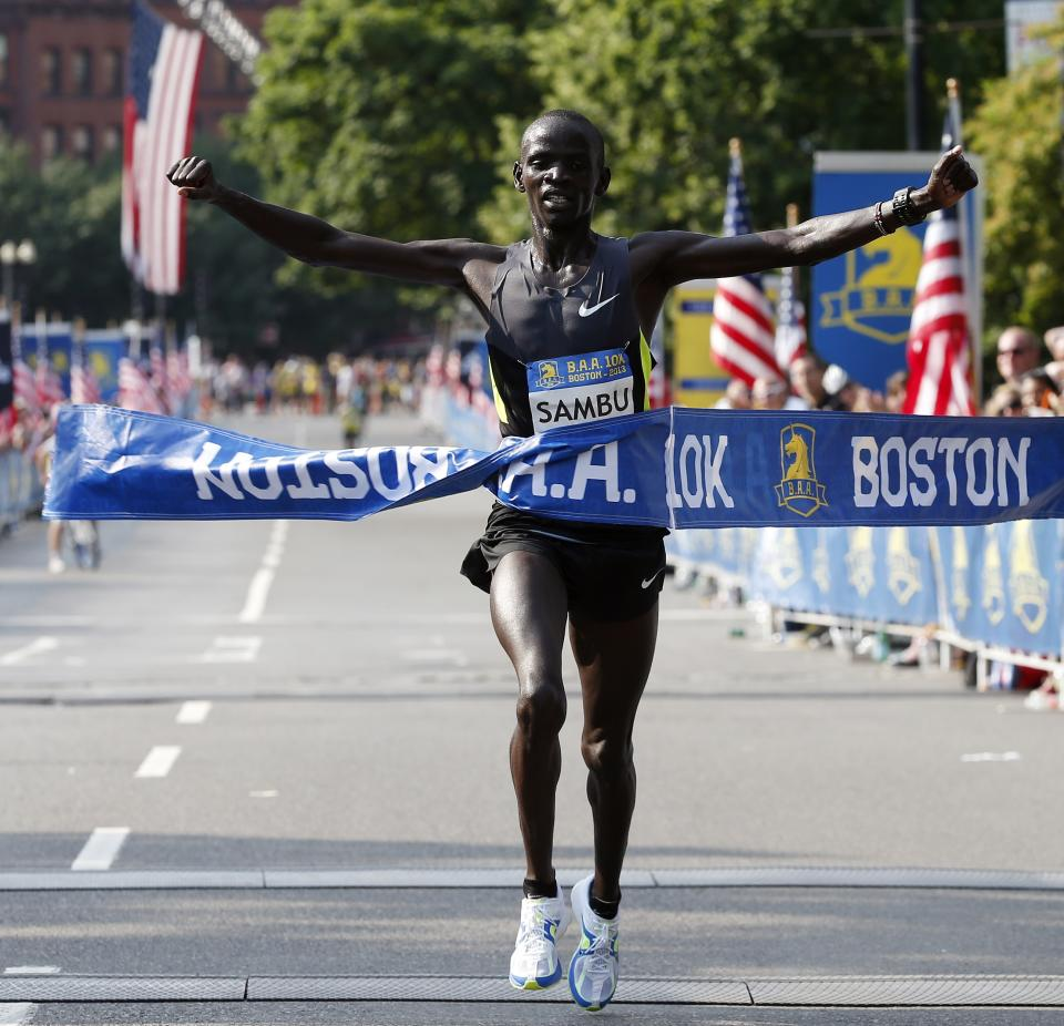 Stephen Sambu, of Kenya, wins the men's division of the Boston Athletic Association 10k in Boston, Sunday, June 23, 2013. More than 6,400 runners took part in Boston's first major race since the April marathon bombings that killed three people and injured hundreds of others. (AP Photo/Michael Dwyer)