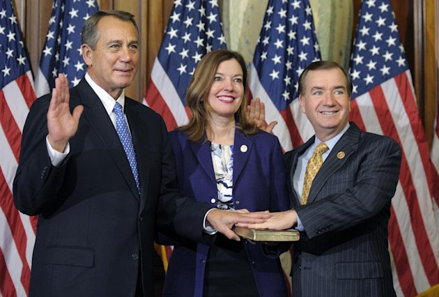 FILE - In this Jan. 3, 2013, file photo, House Speaker John Boehner of Ohio, left, performs a mock swearing in for Rep. Edward Royce, R-Calif., on Capitol Hill in Washington as the 113th Congress began. A harrowing nighttime flight over the African jungle and a wild search for a rebel leader helped forge a relationship between Democratic Sen. Bob Menendez and Royce, two men standing at the forefront of Congress' changing guard on foreign policy. It was May 1997 and the lawmakers boarded a small plane to the African bush to plead with Jonas Savimbi, leader of UNITA, about ordering his forces to put down their arms and end the Angolan civil war. Nearly 16 years later, the two are together again, collaborating as the new chairmen of the respective Senate Foreign Relations and House Foreign Affairs committees. (AP Photo/Cliff Owen)
