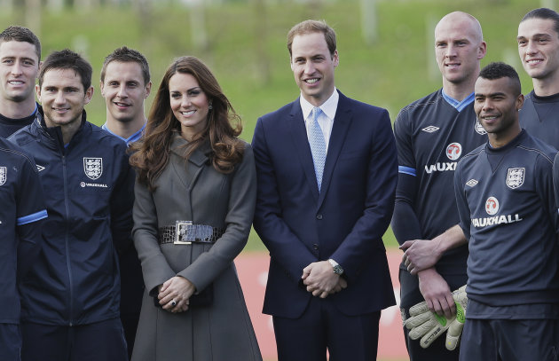 Prince William and Kate, Duchess of Cambridge stand with members of the England football squad at St George's Park near Burton Upon Trent in Staffordshire, England,Tuesday, Oct. 9, 2012. Britain's Duk