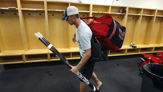Carolina Hurricanes' Eric Staal leaves the locker room after an informal workout for the NHL hockey team at Raleigh Center Ice on Friday, Sept. 14, 2012, in Raleigh, N.C. Staal was taking his gear, which is normally stored in the lockers, with him as the players will not be allowed to use the facility in the event of an NHL lockout. (AP Photo/The News & Observer, Ethan Hyman) MANDATORY CREDIT