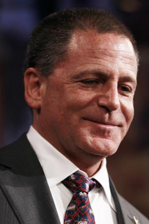 Cleveland Cavaliers owner Dan Gilbert smiles after it was announced his team won first place during the 2011 NBA basketball draft lottery, Tuesday, May 17, 2011 in Secaucus, N.J. (AP Photo/Julio Cortez)