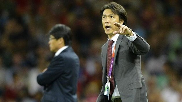 South Korea's coach Myung Bo Hong shouts instructions to his players (Reuters)