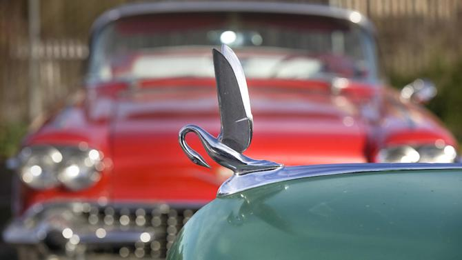 """In this photo taken Monday, Jan. 7, 2013, car collector Chuck Shubb's 1948 Packard Super 8 Touring Sedan's Cormorant hood ornament is seen in Los Angeles.  The vintage car is featured in the film, """"Gangster Squad."""" To bring the story of mobster Mickey Cohen's reign over post-war Los Angeles to life, the director of """"Gangster Squad"""" employed Sean Penn, Josh Brolin, Ryan Gosling and more than 100 irreplaceable vintage American cars.  (AP Photo/Damian Dovarganes)"""