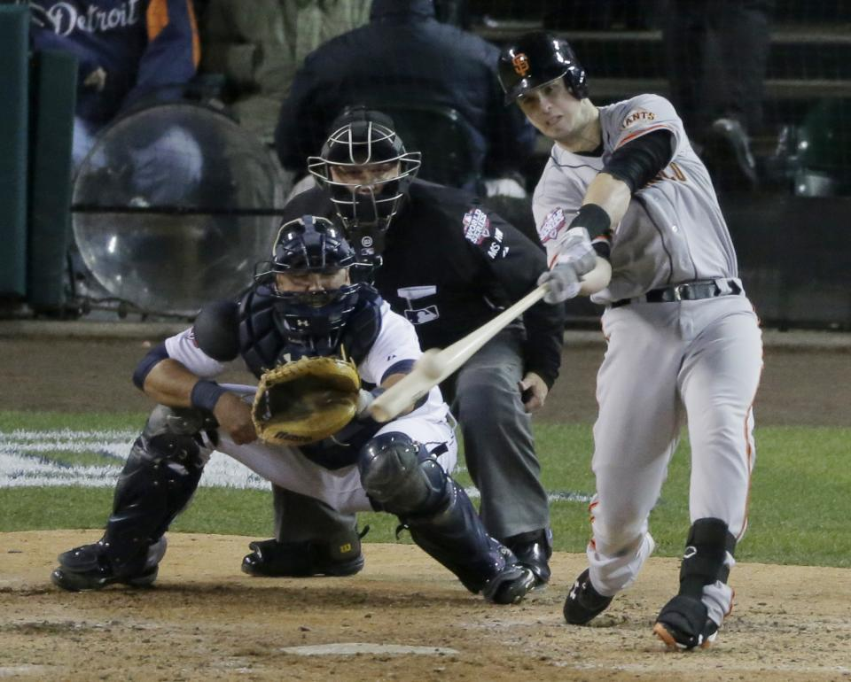 San Francisco Giants catcher Buster Posey hits a two-run home run during the sixth inning of Game 4 of baseball's World Series Sunday, Oct. 28, 2012, in Detroit. (AP Photo/Charlie Riedel)