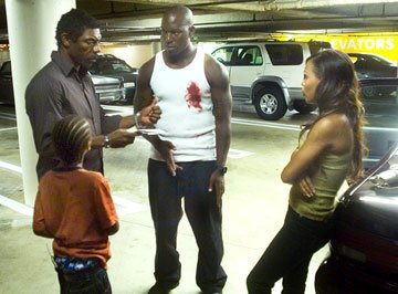 Director Vondie Curtis Hall with Tyrese Gibson and Meagan Good on the set of Rogue Pictures' Waist Deep