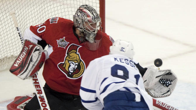 Toronto Maple Leafs' Phil Kessel fires the puck at Ottawa Senators goalie Robin Lehner during the second period of an NHL hockey game in Ottawa, Tuesday, Sept. 27, 2011. (AP Photo/The Canadian Press, Adrian Wyld)