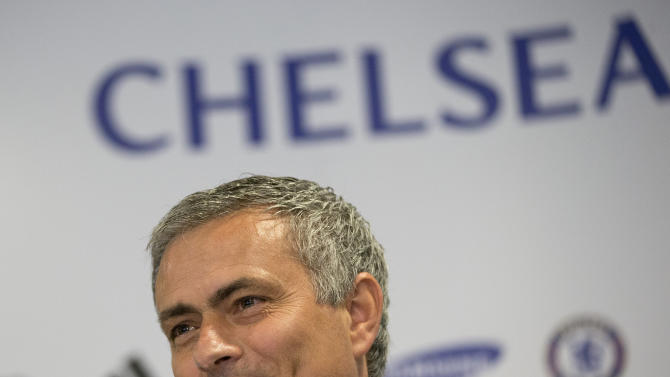 Chelsea's new manager Jose Mourinho speaks to the media during a press conference at Chelsea's Stamford Bridge stadium in London, Monday June 10, 2013. Mourinho has been reappointed coach of Chelsea for the second time. (AP Photo/Alastair Grant)