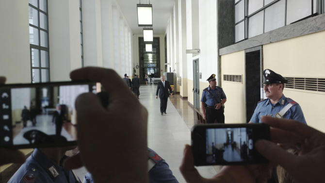 Former Premier Silvio Berlusconi's layer Pietro Longo, third form right, walks outside the courtroom as reporters takes images with cell phones in Milan, Italy, Monday, June 24, 2013. Berlusconi faces a verdict in his sensational sex-for-hire trial, charges that could bring an end to his two-decade political career. The former Premier is charged with paying an under-age Moroccan teen for sex and then trying to cover it up with phone calls to Milan police officials when she was picked up for alleged theft. Berlusconi and the woman deny having had sex with each other. A court is expected to deliver a verdict Monday. (AP Photo/Luca Bruno)