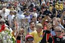 Juan Pablo Montoya, of Colombia, celebrates after winning the 99th running of the Indianapolis 500 auto race at Indianapolis Motor Speedway in Indianapolis, Sunday, May 24, 2015. (AP Photo/Darron Cummings)