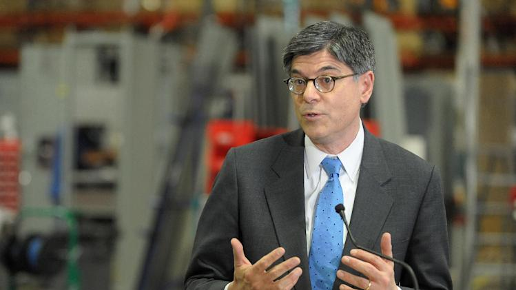 Treasury Secretary Jacob Lew speaks after touring the Siemens manufacturing plant where electrical drive components for heavy machinery are assembled in Alpharetta, Ga., Thursday, March 14, 2013. Some of the company's large traction drive clients include AMTRAK, Caterpillar and the new Atlanta Streetcar initiative. (AP Photo/David Tulis)