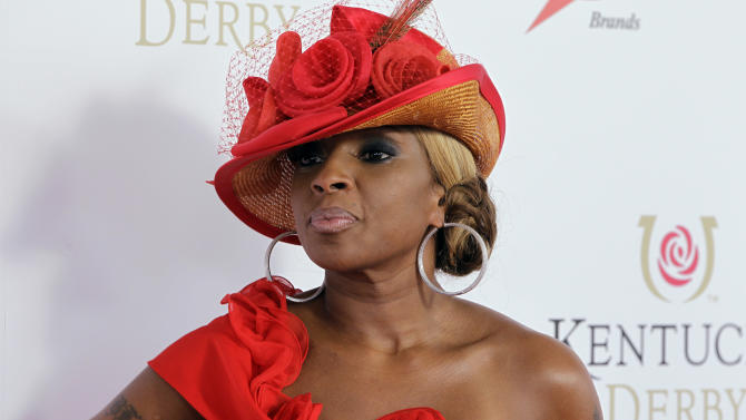"""FILE - In this May 5, 2012 file photo, singer Mary J Blige arrives for the 138th Kentucky Derby horse race at Churchill Downs, in Louisville, Ky. Blige says the Burger King commercial that caused major backlash for the singer was a """"mistake."""" The clip was released in April and featured Blige singing about the fast-food chain's new chicken snack wraps. It immediately went viral, and some in the black community said it was stereotypical. Burger King pulled it after one day and said it was unfinished. (AP Photo/Darron Cummings, File)"""