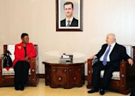 Syrian Foreign Minister Walid al-Muallem (R) meets with UN humanitarian chief Valerie Amos in Damascus. Amos entered the battered Homs neighbourhood of Baba Amr on Wednesday along with a team from the Syrian Red Crescent, as efforts continued apace to bring an end to a year of deadly violence in the country