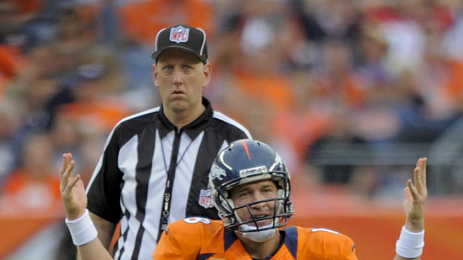 Denver Broncos quarterback Peyton Manning (18) reacts after a sack in the fourth quarter of an NFL football game against the Houston Texans, Sunday, Sept. 23, 2012, in Denver. (AP Photo/Jack Dempsey)