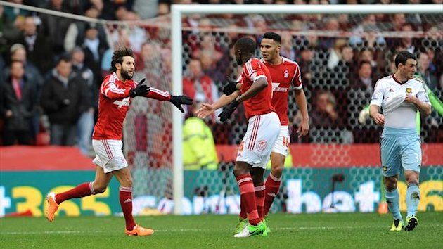Nottingham Forest's Djamal Abdoun (left) celebrates with Guy Moussi after scoring against West Ham