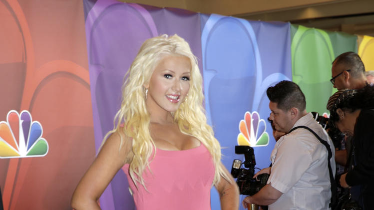 "This image released by NBC shows Christina Aguilera at ""The Voice"" session during the NBCUniversal Press Tour in Beverly Hills, Calif., on Saturday, July 27, 2013. (AP Photo/NBC, Paul Drinkwater)"