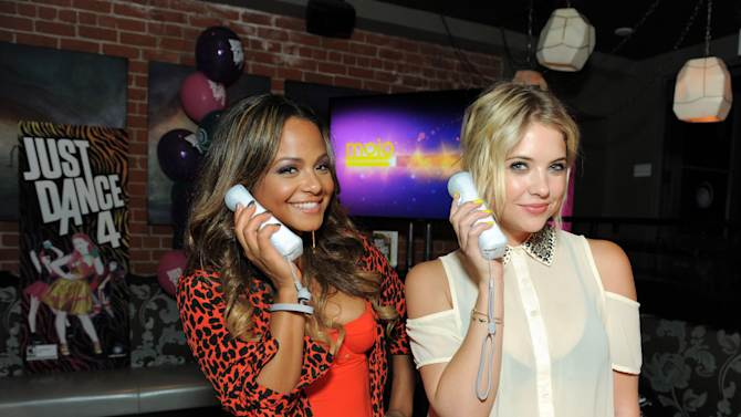 """Party hosts Christina Milian, left, and Ashley Benson dance to Carly Rae Jepsen's """"Call Me Maybe"""", featured on Ubisoft's Just Dance 4, at the launch party on Tuesday, Oct. 2, 2012 in Los Angeles. Just Dance 4 hits store shelves on Tuesday, Oct. 9, 2012.(Photo by Jordan Strauss/Invision for Ubisoft/AP Images)"""