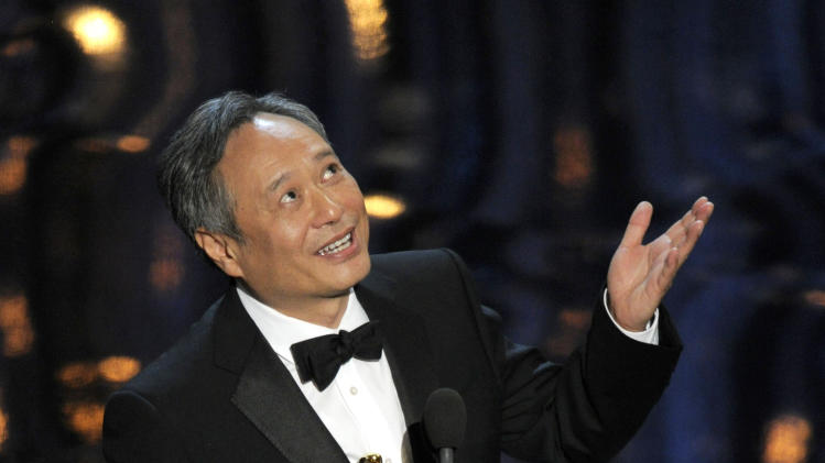 "Ang Lee accepts the award for best directing for ""Life of Pi"" during the Oscars at the Dolby Theatre on Sunday, Feb. 24, 2013, in Los Angeles.  (Photo by Chris Pizzello/Invision/AP)"