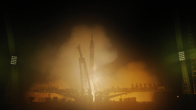 Russian craft docks with space station after delay