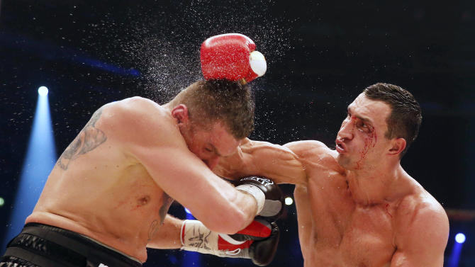 Ukrainian WBA, WBO, IBO and IBF heavy weight boxing world champion Vladimir Klitschko lands a blow on Polish challenger Mariusz Wach during their title bout in Hamburg