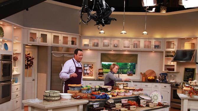 "This undated publicity photo provided by QVC, shows QVC program host David Venable and Tara McConnell on set from Temp-tations during one of QVC's ""In the Kitchen with David ®"" broadcasts. (AP Photo/QVC)"
