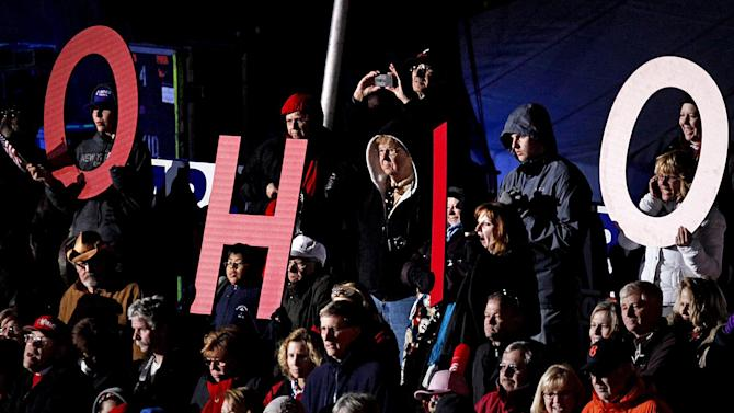 """Supporters spell out """"Ohio"""" as they cheer for  Republican presidential candidate, former Massachusetts Gov. Mitt Romney, not pictured, as he speaks during a campaign event at The Square at Union Centre, Friday, Nov. 2, 2012, in West Chester, Ohio. (AP Photo/David Goldman)"""