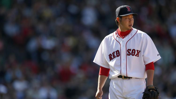 Boston Red Sox's Junichi Tazawa walks to the dug out after pitching in the eighth inning of a baseball game against the Baltimore Orioles in Boston, Saturday, April 19, 2014. (AP Photo/Michael Dwyer)