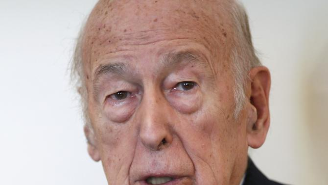 Former French President Valery Giscard d'Estaing speaks during an interview with Reuters in his office in Paris
