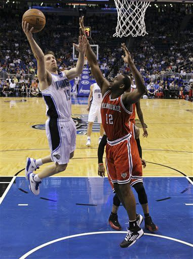 Magic rally late in 4th, beat Bucks 113-103 in OT