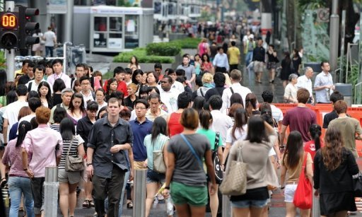 Pedestrians walk along the street of Orchard Road in Singapore's upmarket shopping belt. Businesses along the famous shopping street plan to deploy trained hawks to scare off thousands of birds whose droppings rain down on pedestrians' heads, a report said