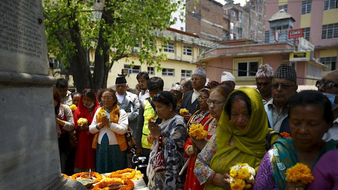 Nepalese people pay tribute to the April 25 earthquake victims at Kathmandu