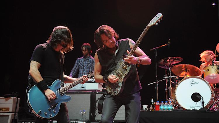 Musician Dave Grohl, left, and Rick Springfield perform on stage at the Sound City Players concert at The Manhattan Center Hammerstein Ballroom, Wednesday, Feb. 13, 2013, in New York. (Photo by Brad Barket/Invision/AP)