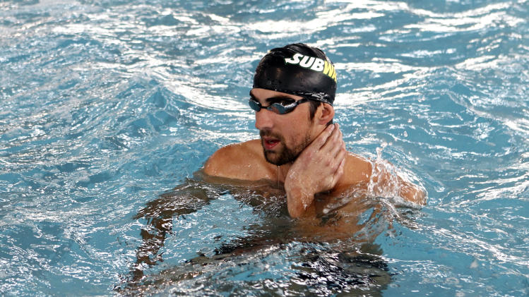 Olympic swimming champion Michael Phelps joins his sister Whitney in the pool for a cross training swim as she prepares to run the ING New York City Marathon with Team SUBWAY at the Chelsea Piers Sport Center, Monday, Oct. 15, 2012 in New York. (Photo by Jason DeCrow/Invision for SUBWAY/AP Images)