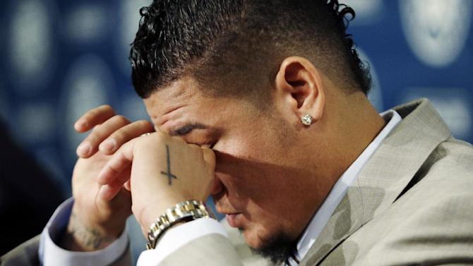 """Seattle Mariners' Felix Hernandez dries his eyes during a news conference, Wednesday, Feb. 13, 2013, in Seattle. Hernandez, who repeatedly said, """"I will not disappoint anybody,"""" signed a seven-year contract with the Mariners that makes him the highest-paid pitcher in baseball. The new deal will be worth $175 million. (AP Photo/Elaine Thompson)"""