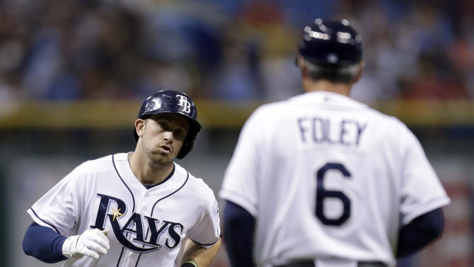 Tampa Bay Rays' Evan Longoria shakes hands with third base coach Tom Foley after hitting a first inning home run off Boston Red Sox starting pitcher John Lackey during a baseball game Monday, June 10, 2013, in St. Petersburg, Fla. (AP Photo/Chris O'Meara)