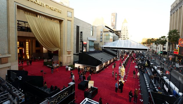 People prepare the red carpet at the Dolby Theatre for the 85th Academy Awards in Los Angeles. (Credit: PA)
