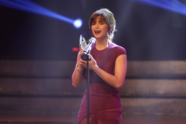 Angel Locsin wins the Movie Actress of the Year award for One More Try, at the 29th PMPC Star Awards for Movies awards night, held at the AFP Theater in Camp Aguinaldo, Quezon City on 10 March 2013. (George Calvelo/NPPA Images)