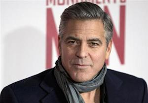 """Actor and director George Clooney arrives for the UK premiere of his film """"The Monuments Men"""" in London"""