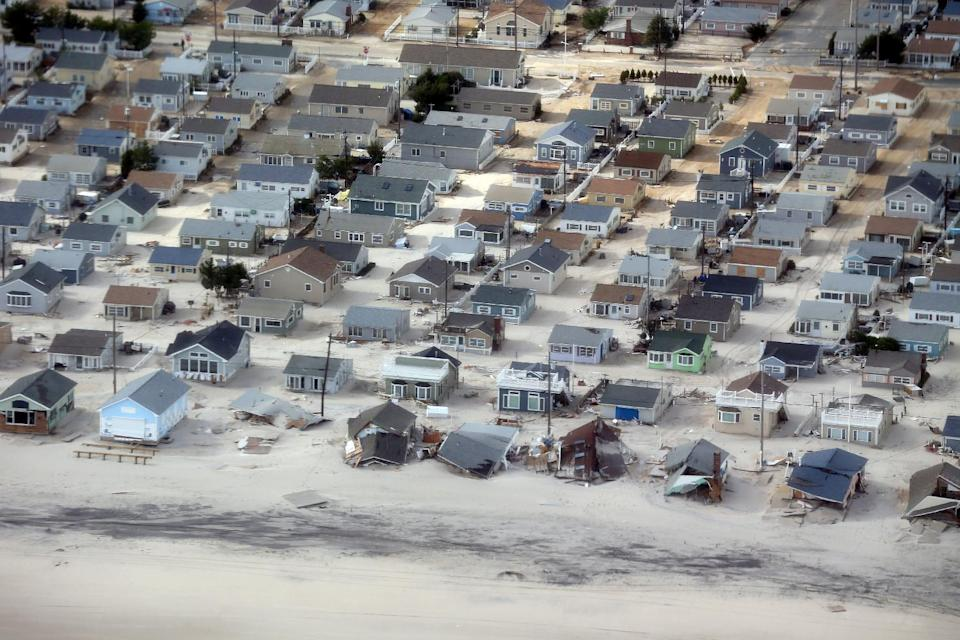 This aerial view of storm damage over the Atlantic Coast in Seaside Heights, N.J.,  Wednesday, Oct. 31, 2012, taken from a helicopter traveling behind the helicopter carrying President Obama and New Jersey Gov. Chris Christie, as they viewed storm damage from superstorm Sandy.   (AP Photo/Doug Mills, Pool)