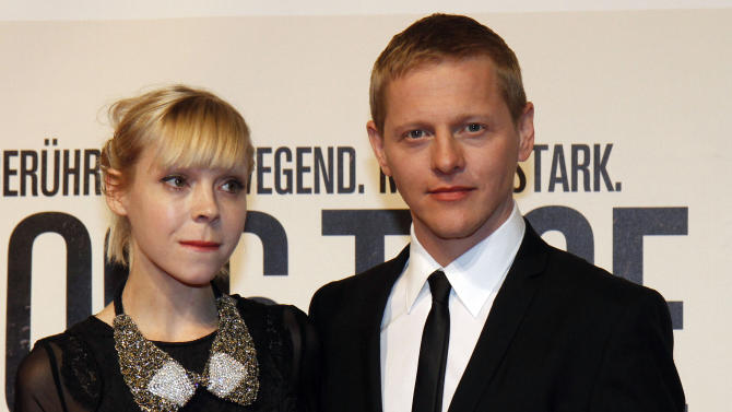 """British actress Antonia Campbell-Hughes, and Danish actor Thure Lindhardt, right, pose for photographers before the premiere of the film """"3096 Days"""" in Vienna, Austria, Monday Feb. 25, 2013.  The film tells the story of Natascha Kampusch who was abducted as a schoolgirl and held prisoner in a cellar for almost nine years. (AP Photo/Ronald Zak)"""