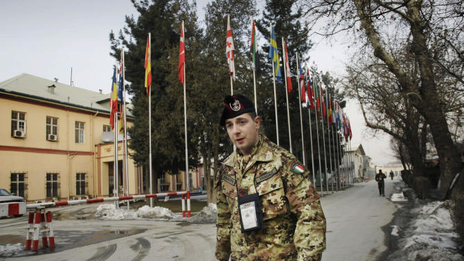 In this Sunday, Jan. 27, 2013 photo, an Italian soldier with the NATO-led International Security Assistance Force (ISAF) troops walks at the compound of NATO's head quarters in Kabul, Afghanistan. U.S. Marine Gen. John Allen, the top commander of the ISAF troops in Afghanistan, has expressed confidence that Afghan security forces will be able tackle the insurgency when they take the lead in the 11-year-old war against the Taliban this spring, and will be able to hold their own against the Taliban on the battle field without the presence of foreign troops fighting on the front line. (AP Photo/Musadeq Sadeq)