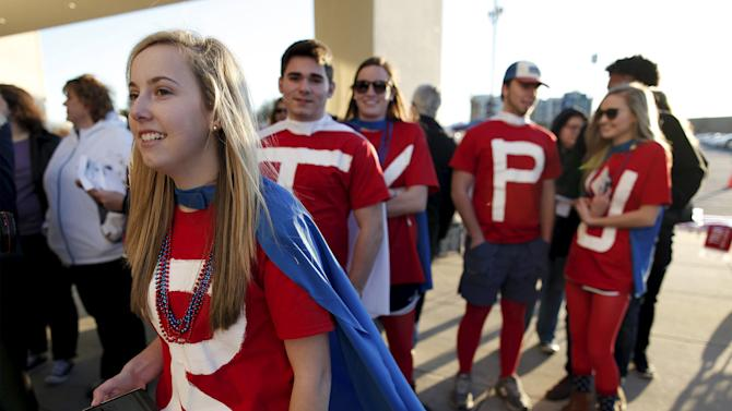 Jordan Bramlett, a student at Hartsville High School in Hartsville, South Carolina, dresses with fellow students as caped crusaders for Trump in Florence