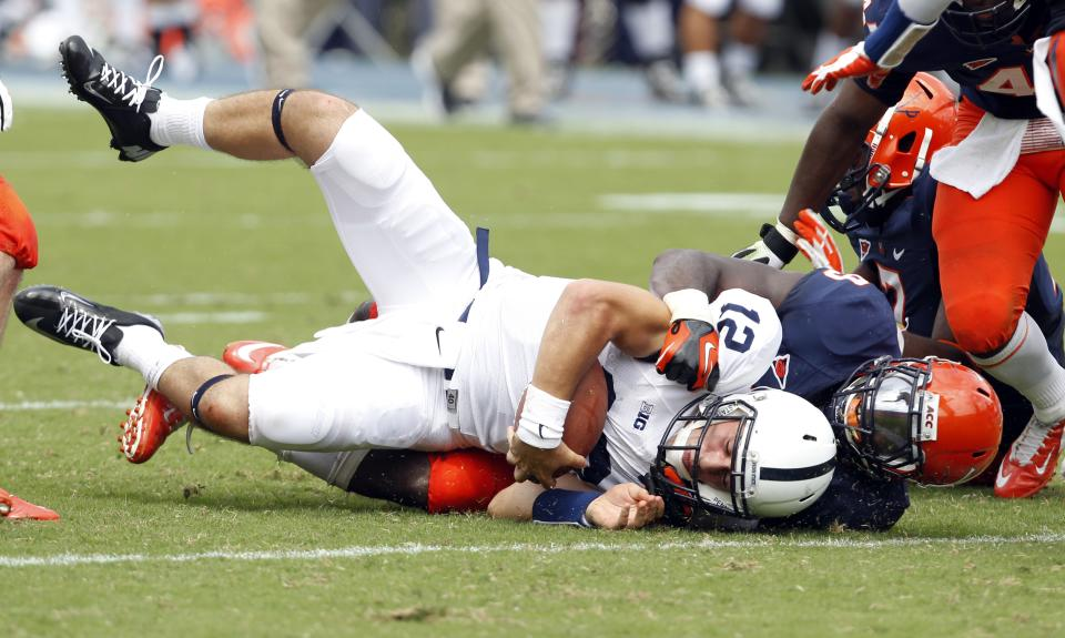 Penn State quarterback Steven Bench (12) is tackled by Virginia linebacker LaRoy Reynolds (9) during the first half of an NCAA college football game Saturday Sept. 8, 2012, in Charlottesville, Va. (AP Photo/Andrew Shurtleff