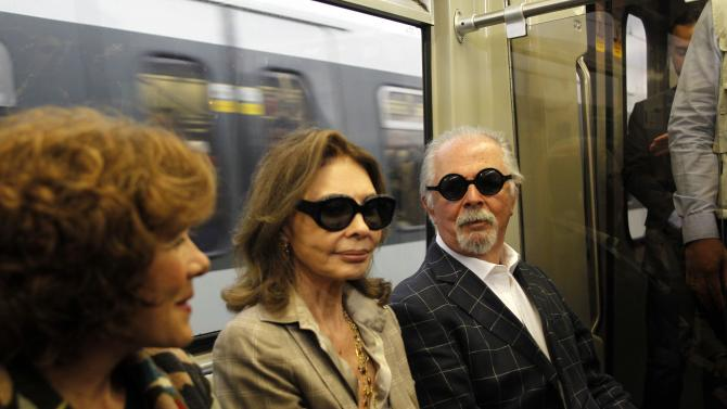 "Colombian painter and sculptor Botero and his wife Vari travel on the Train of Culture, during a news conference for the exhibition ""Fernando Botero: The Circus"", in Medellin"