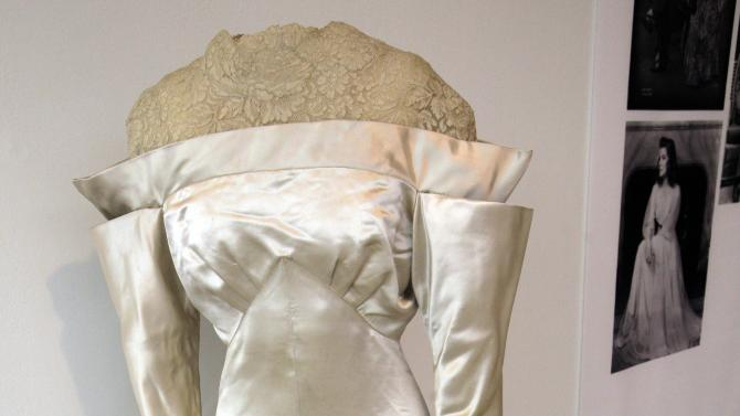 """A white satin and lace wedding dress by Howard Greer, from the 1934 production of """"The Lake,"""" is shown as part of the """"Katharine Hepburn: Dressed for Stage and Screen"""" exhibit in the New York Public Library for the Performing Arts at Lincoln Center,  Tuesday, Oct. 16, 2012. (AP Photo/Richard Drew)"""
