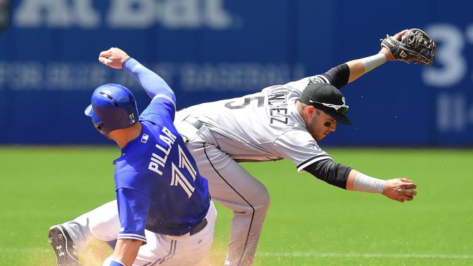 Toronto Blue Jays' Kevin Pillar slides in safely at second base past Chicago White Sox's Carlos Sanchez during the seventh inning of a baseball game in Toronto, Wednesday, May 27, 2015. (Frank Gunn/The Canadian Press via AP) MANDATORY CREDIT