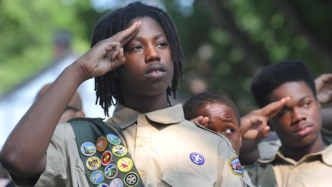 Stevon Spears, 17 and members of Boy Scout Troop 445 salute the American flag during the Memorial Day observance ceremony at the Memphis National Cemetery in Memphis, Tenn. Saturday, May 26, 2012. For 29 years members of the Boy Scouts, Girl Scouts and American Heritage Girls have placed flags on the 42,000 graves at the Memphis National Cemetery during a ceremony honoring veterans for the Memorial Day Celebration. (AP Photo/The Commercial Appeal, Chris Desmond)